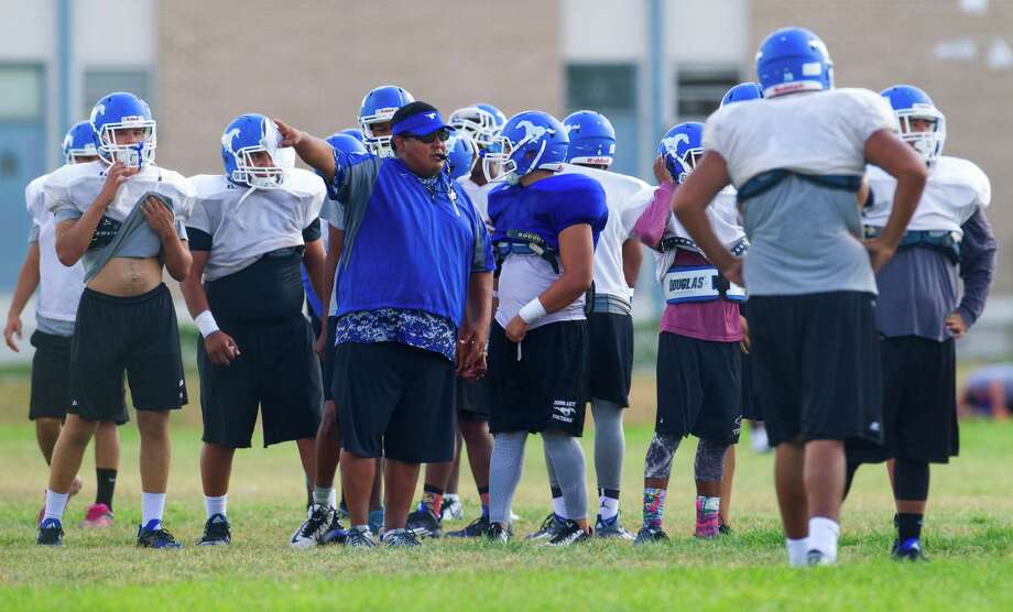 John Jay High School football coach Gary Gutierrez directs players Tuesday afternoon, Sept. 8, 2015 during the first practice since two of their varsity players, Victor Rojas and Mike Moreno, were suspended indefinitely, pending investigation, over violently hitting a referee at the end of last Friday's road game in Marble Falls. Photo: William Luther, Staff / San Antonio Express-News / © 2015 San Antonio Express-News