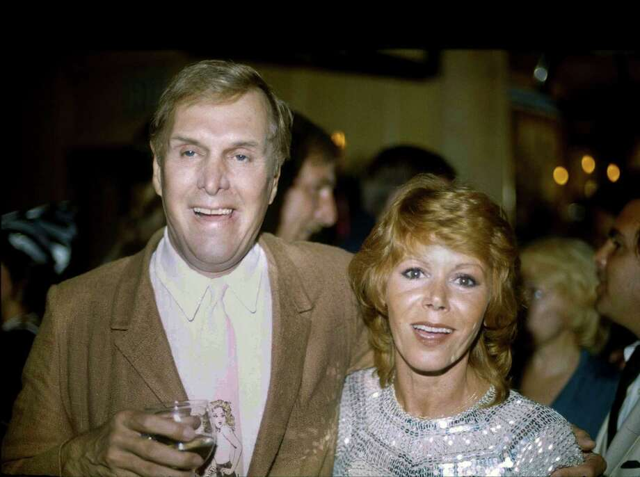 "FILE - In this Tuesday, Sept. 13, 1983 file photo, actors Judy Carne and Alan Sues, left, of ""Rowan And Martin's Laugh-In"" are shown during a ""Laugh-In"" reunion party, in Los Angeles. ""Laugh-In"" star Judy Carne has died in a British hospital. She was 76. She was famous for popularizing the ""Sock it to Me"" phrase on the hit TV show that started in the late 1960s. Her death was confirmed Tuesday, Sept. 8, 2015 in an e-mail by Eva Duffy, spokeswoman for Northampton General Hospital. Duffy said Carne died in the hospital on September 3. Newspaper reports said she had suffered from pneumonia. (AP Photo/Doug Pizac, file) Photo: Doug Pizac, STF / AP"