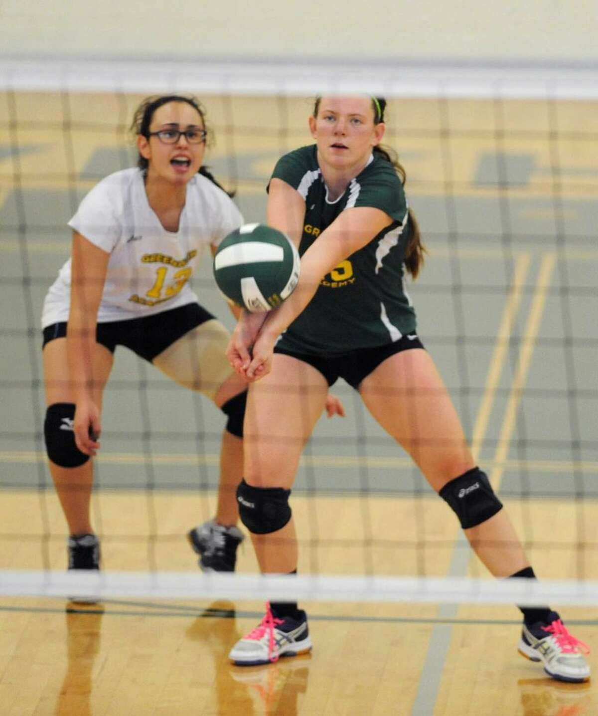 Phoebe Morris, front, and Paloma Corrigan are senior captains on the Greenwich Academy volleyball team.
