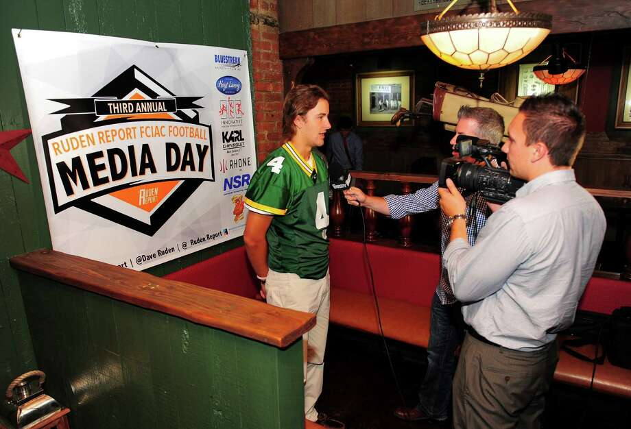 Trinity Catholic's Johnny Sommers is interviewed by a crew from MSG Varsity network during the 3rd Annual Ruden Report FCIAC Footbal Media Day held at Bogey's Grill & Tap Room in Norwalk, Conn. on Tuesday Sept. 8, 2015. Photo: Christian Abraham / Hearst Connecticut Media / Connecticut Post