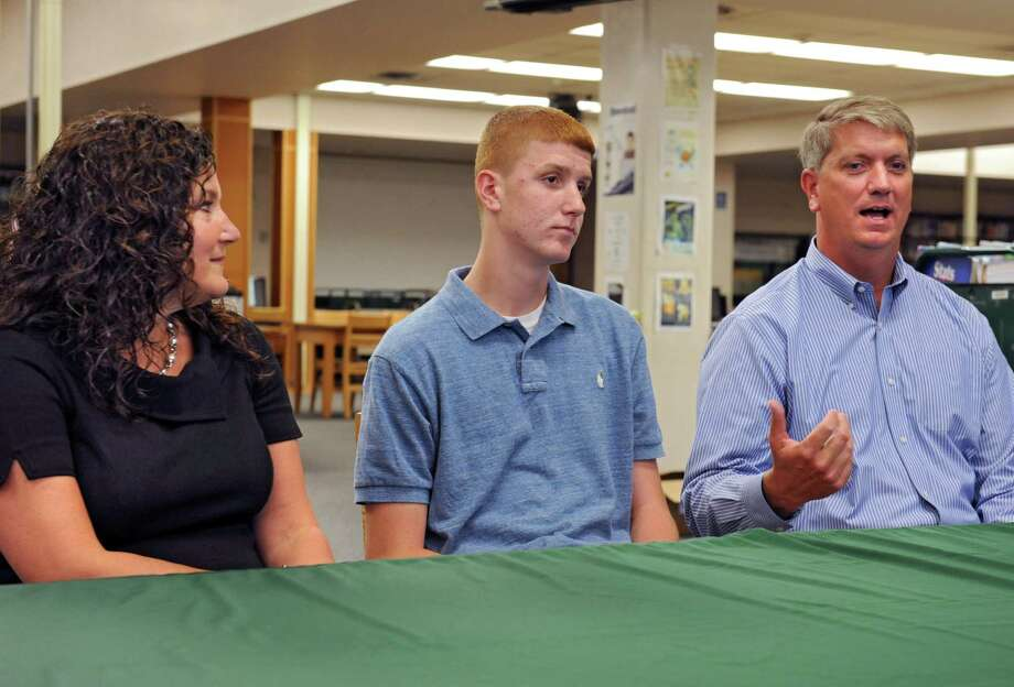 Shenendehowa High School basketball player Kevin Huerter sits in between his parents Erin and Tom as he announces his intentions to play his college basketball at the University of Maryland during a press conference on Tuesday Sept. 8, 2015 in Clifton Park, N.Y.  (Lori Van Buren / Times Union) Photo: Lori Van Buren / 00033258A