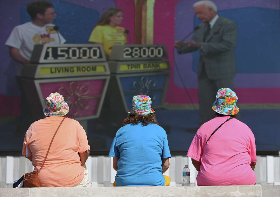 "The ""South Padre Island Girls"", (from left) Stacey Presley, Linda Presley and Mary Ann Yznaga, watch old Bob Barker shows on a screen outside as registrants arrive to sign up for the Price is Right show at the Tobin Center on September 8, 2015. The show is a travelling likeness to the on-air television game show hosted by Drew Carrie since 2007. The travelling show is giving away more than $10 million in cash and prizes as it travels around the country. The show will be at teh Tobin Center for another two days. For more information, go to https://www.tobincenter.org/box-office/2015-09/price-right-live Photo: Tom Reel /San Antonio Express-News"