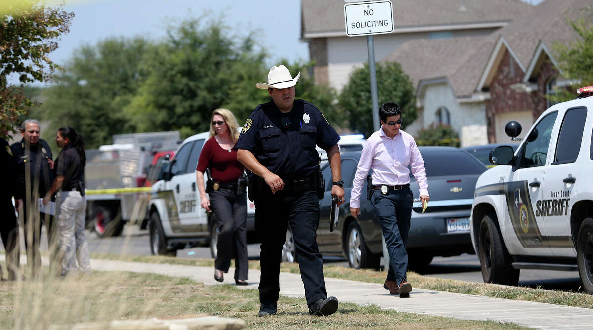In this photo taken Aug. 28, the Bexar County Sheriff's Department investigates the scene where deputies shot Gilbert Flores as they responded to a domestic disturbance call in Northwest Bexar County.