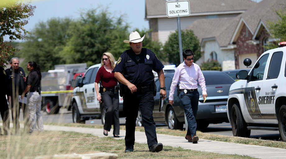 In this photo taken Aug. 28, the Bexar County Sheriff's Department investigates the scene where deputies shot Gilbert Flores as they responded to a domestic disturbance call in Northwest Bexar County. Photo: John Davenport /Associated Press / San Antonio Express-News