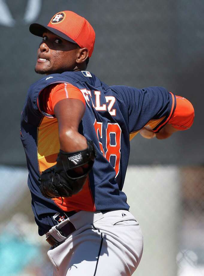 Houston Astros starting pitcher Michael Feliz (68) pitches during spring training workouts for pitchers and catchers at their Osceola County training facility, Sunday, Feb. 22, 2015, in Kissimmee. ( Karen Warren / Houston Chronicle  ) Photo: Karen Warren, Staff / © 2015 Houston Chronicle