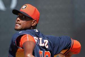 Houston Astros starting pitcher Michael Feliz (68) pitches during spring training workouts for pitchers and catchers at their Osceola County training facility, Sunday, Feb. 22, 2015, in Kissimmee. ( Karen Warren / Houston Chronicle  )