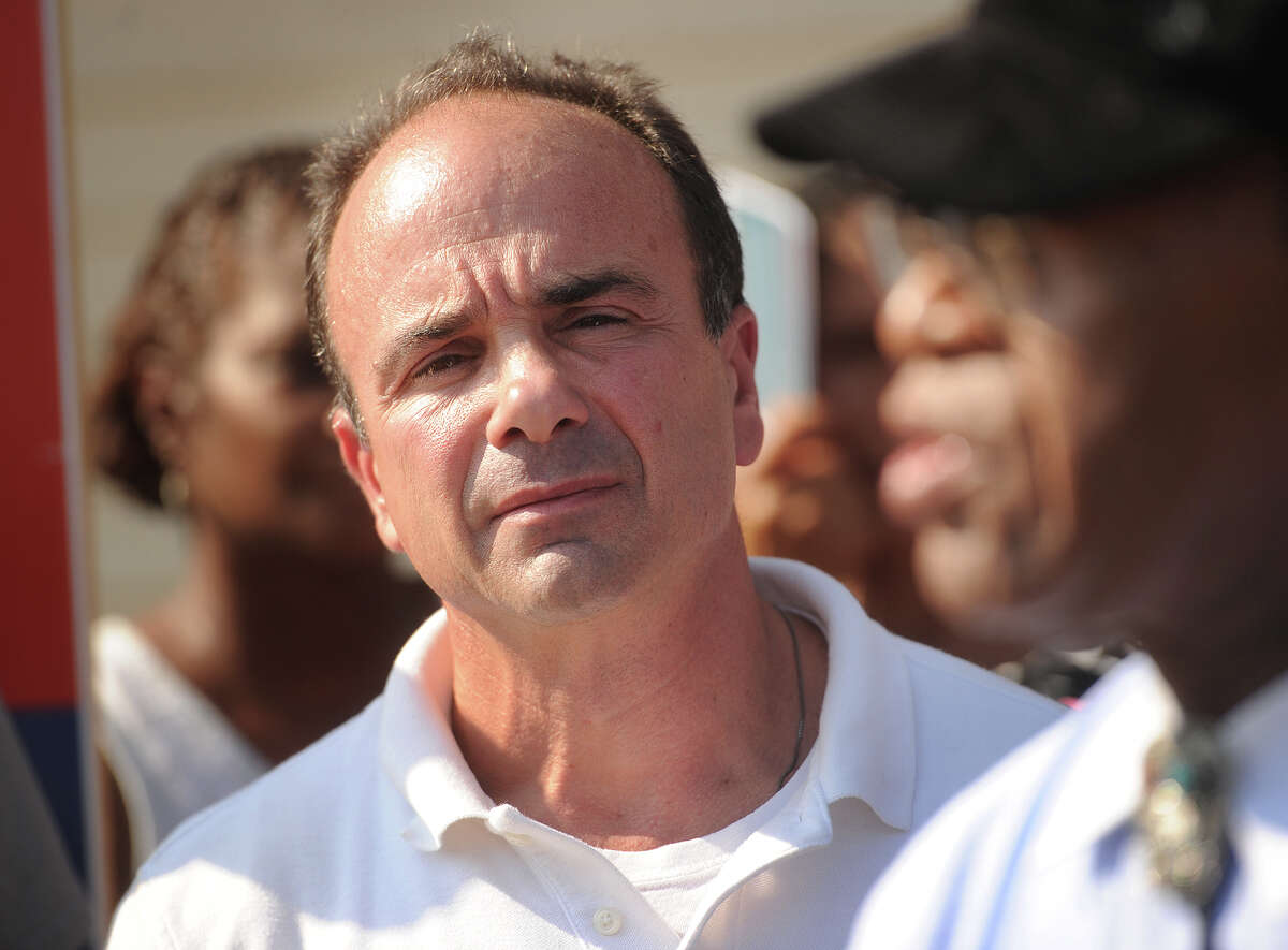 Ex-Bridgeport mayor and current mayoral candidate Joe Ganim listens to statements of support by a variety of African American ministers outside his campaign headquarters at 12 Hudson Street in Bridgeport, Conn. on Tuesday, September 8, 2015. An earlier press conference had accused Ganim of support and advocacy on behalf of a member of the Klu Klux Klan.