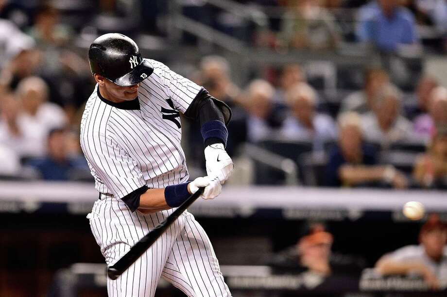 NEW YORK, NY - SEPTEMBER 08:  Alex Rodriguez #13 of the New York Yankees hits a home run in the sixth inning against the Baltimore Orioles at Yankee Stadium on September 8, 2015 in New York City.  (Photo by Steven Ryan/Getty Images) ORG XMIT: 538594479 Photo: Steven Ryan / 2015 Getty Images