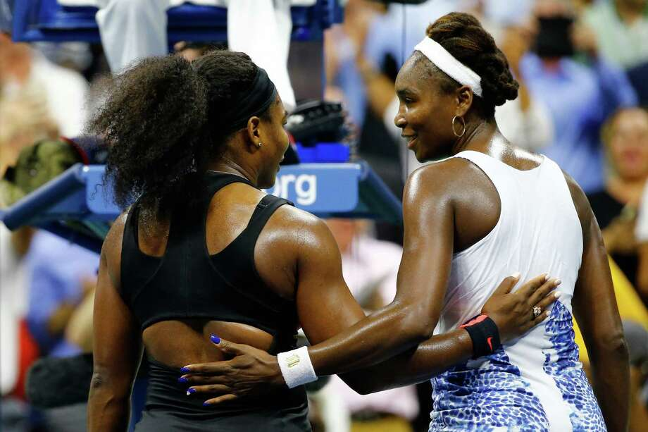 The hard-fought match ended with what has become the usual result for the Williams sisters as Serena, left, improved to 16-11 all-time against Venus. Photo: Al Bello, Staff / 2015 Getty Images