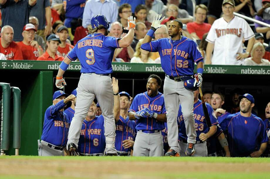 WASHINGTON, DC - SEPTEMBER 08:  Kirk Nieuwenhuis #9 of the New York Mets celebrates with Yoenis Cespedes #52 after hitting ended up being the game-winning home run in the eighth inning against the Washington Nationals at Nationals Park on September 8, 2015 in Washington, DC. New York won the game 8-7.  (Photo by Greg Fiume/Getty Images) ORG XMIT: 538594483 Photo: Greg Fiume / 2015 Getty Images