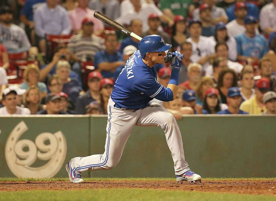 BOSTON, MA - SEPTEMBER 8: Troy Tulowitzki #2 of the Toronto Blue Jays knocks in the winning run in the tenth inning against the Boston Red Sox at Fenway Park on September 8, 2015 in Boston, Massachusetts.  (Photo by Jim Rogash/Getty Images) ORG XMIT: 538594523 Photo: Jim Rogash / 2015 Getty Images