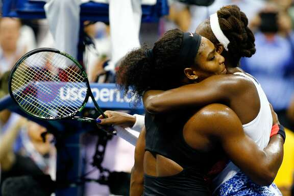 NEW YORK, NY - SEPTEMBER 08:  Serena Williams (L) of the United States hugs Venus Williams of the United States after defeating her in their Women's Singles Quarterfinals match on Day Nine of the 2015 US Open at the USTA Billie Jean King National Tennis Center on September 8, 2015 in the Flushing neighborhood of the Queens borough of New York City.  (Photo by Al Bello/Getty Images)