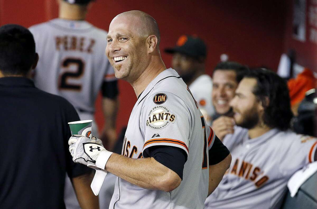 San Francisco Giants' Tim Hudson smiles in the dugout after hitting a home run against the Arizona Diamondbacks during the third inning of a baseball game Tuesday, Sept. 8, 2015, in Phoenix. (AP Photo/Ross D. Franklin)