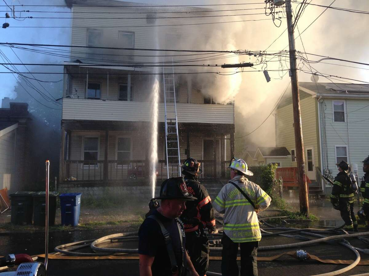 Bridgeport firefighters battle a fire at a Berkshire Avenue house on Wednesday, Sept. 9, 2015.