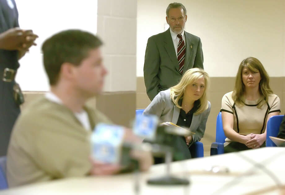 Hillary Buchanan, right, and Adrienne Bak, second from right, listen to Alex Kelly testify before the state parole board in Suffield, Conn., March 3, 2005. Kelly was convicted in 1997 of raping both Bak and Buchanan in 1986. Photo: AP File Photo / POOL AP