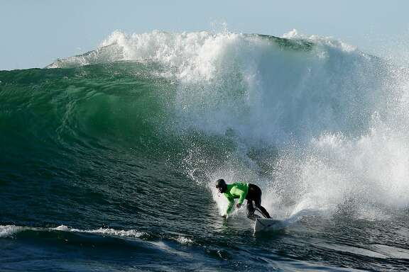 HALF MOON BAY, CA - JANUARY 20:  Shawn Dollar competes in the finals during the Mavericks Invitational surf competition on January 20, 2013 in Half Moon Bay, California.  (Photo by Ezra Shaw/Getty Images)