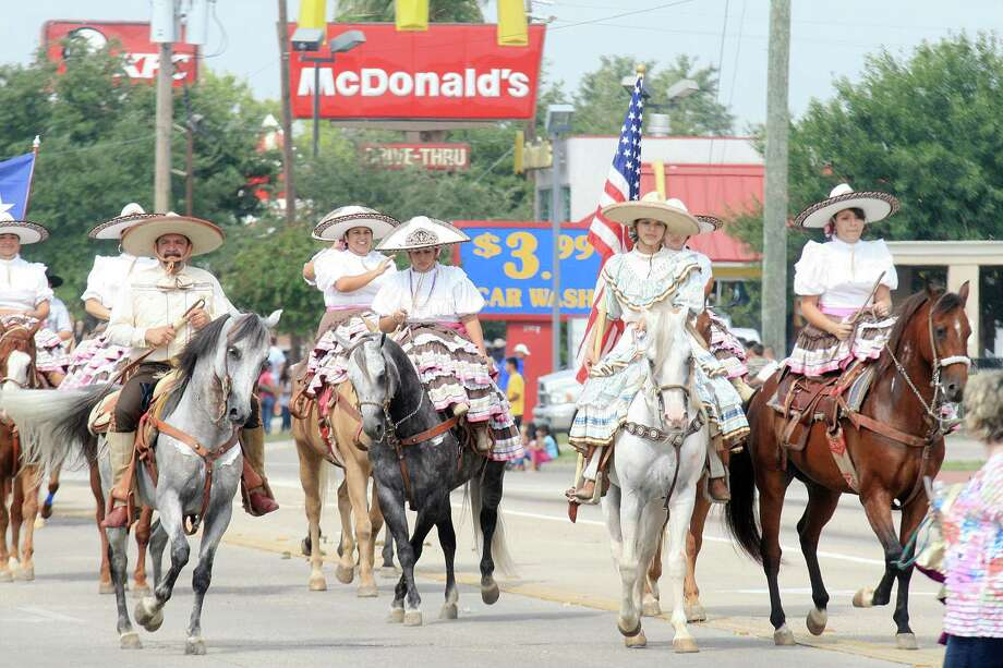 Stereotypes on paradeWe're used to questions about whether we ride horses to work while open-carrying our pistols, or if we all wear cowboy hats and giant belt buckles while listening to George Strait. We do, but that's usually only on special occasions like Texas Independence Day or the rodeo.  Photo: Pin Lim, Freelance / Freelance