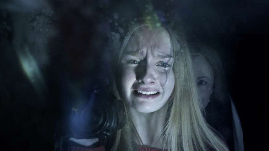 "Olivia DeJonge, foreground, and Deanna Dunagan star in ""The Visit."" Photo: HONS / Universal Pictures"