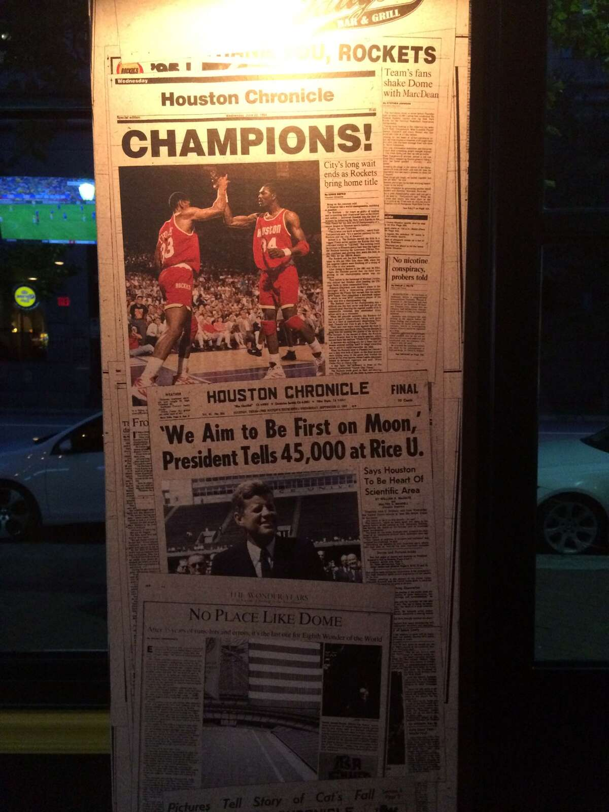 Newspaper clippings decorate Christian's Tailgate at 1012 Congress.