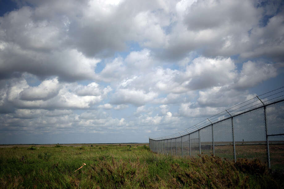 """Fencing surrounds the first phase of a SpaceX construction project near Boca Chica, Texas. """"I'm not sure I'd be comfortable  living that close to it,"""" says a retired NASA engineer who notes that  residents could be exposed to dangerous chemicals used during launches,  such as hydrazine, and falling debris in the event of an explosion. Photo: Luke Sharrett, Bloomberg News"""