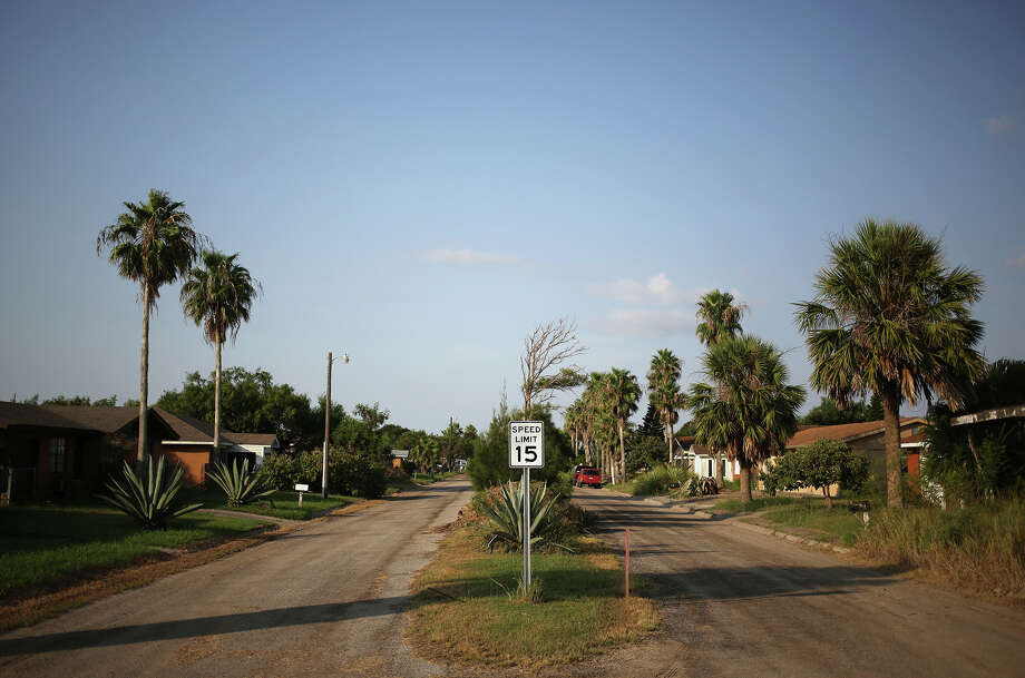 Boca Chica Village, in one of Texas' poorest counties, sits on a dusty  fleck of land between wind-swept sand dunes, emerald marshes and a  desolate white beach. The community of about three dozen houses, filled  with mainly seasonal blue-collar workers and retirees, was built in the  1960s.  Photo: Luke Sharrett, Bloomberg News