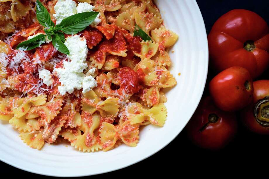 To make fresh tomato sauce at home all you need is tomatoes, olive oil, garlic and basil. Photo: KARSTEN MORAN, New York Times / NYTNS