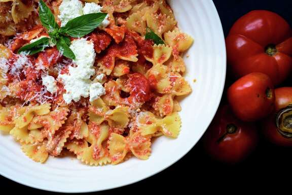 Bow tie pasta with a simple, freshly made tomato sauce, topped with ricotta, in New York, Aug. 18, 2015. Tomatoes are now at their ripest and reddest, so go ahead: make a batch of quick, fresh sauce.