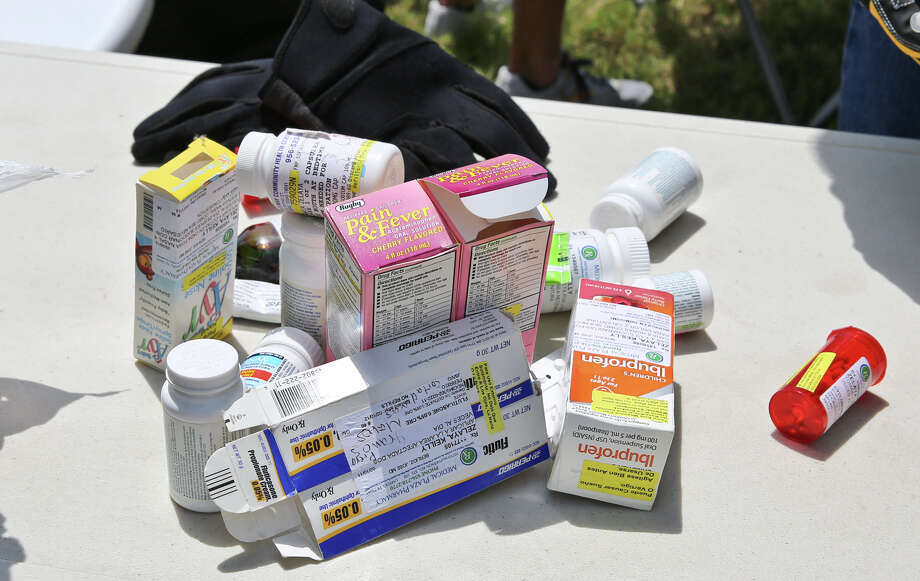 Prescription medication collected by the the U.S. Drug Enforcement Administration is seen on a table before being sealed away for disposal during the National Drug Take-Back Initiative day on April 26, 2014. Photo: Victor Strife / File Photo / LAREDO MORNING TIMES