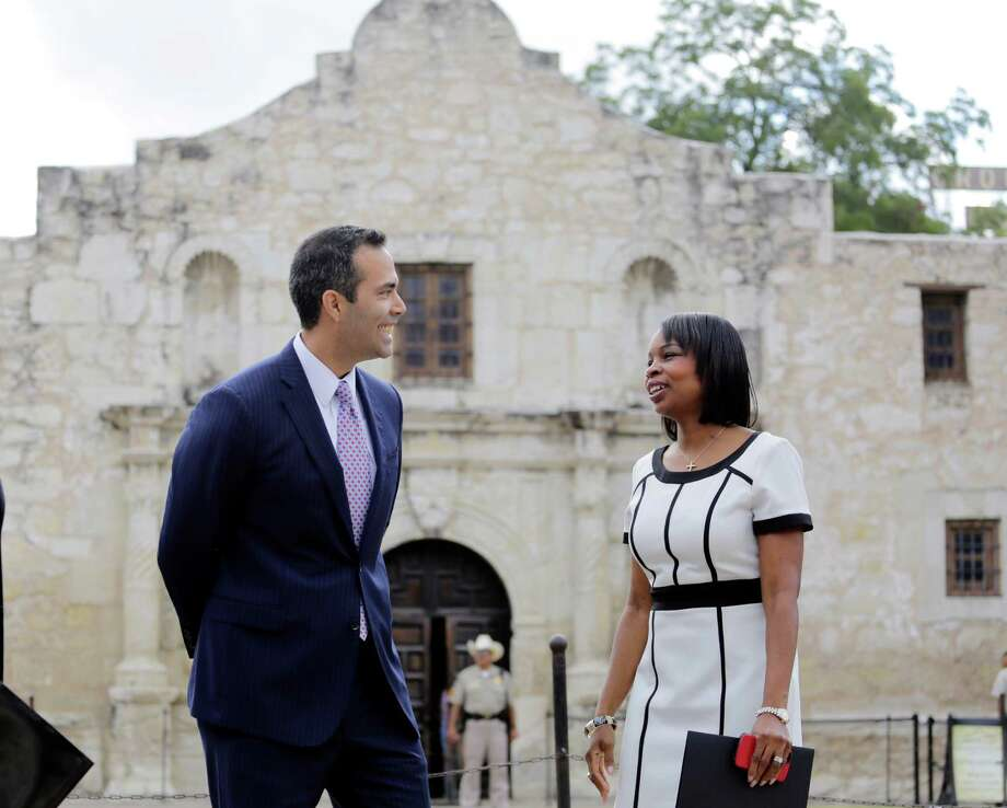 Texas Land Commissioner George P. Bush, left, talks with San Antonio Mayor Ivy Taylor before a news conference to celebrate the $31.5 million the General Land Office received for the preservation and development of the Alamo on Sept. 2. Photo: Eric Gay /Associated Press / AP