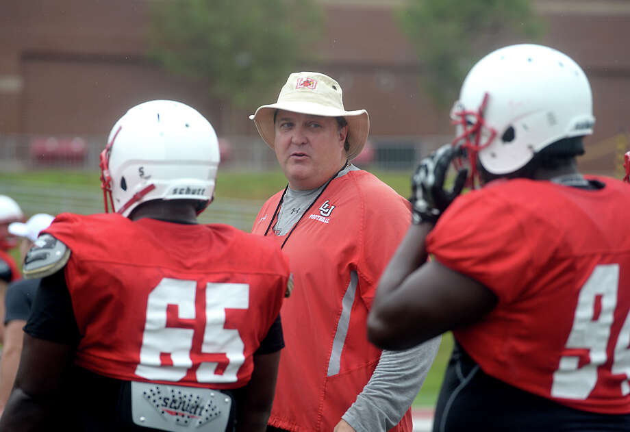 Lamar's head coach Ray Woodard talks with defensive players as he observes team drills as they get in practice Tuesday at Provost Umphrey Stadium. The Cardinals will hold their first home game Saturday. Photo taken Tuesday, September 1, 2015 Photo by Kim Brent Photo: Kim Brent / Beaumont Enterprise