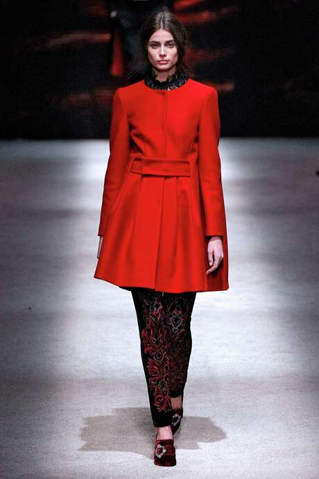 Alberta Ferretti's Rmantic Victorian look of a fitted red coat over a high-neck lace top. Photo: MCV /McClatchy-Tribune News Service / Chicago Tribune