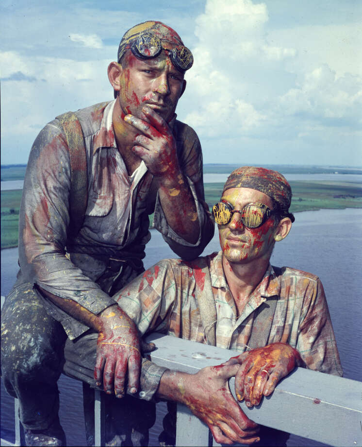 Texas Highways Sept 1957 front cover. Daredevil Paint Job. No these aren't creatures from the Blue Lagoon or men from Mars. They are just more Highway Department employees doing their job. The colors come from having a colorful job. Virgil Ingram, left, and Harold Ringer, right, are two of the painters on the Neches River High Bridge.