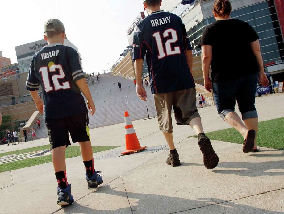 Kids wearing jerseys of quarterback Tom Brady arrive for a New England Patriots preseason game Thursday, Sept. 3. Photo: Bill Sikes, Associated Press / AP