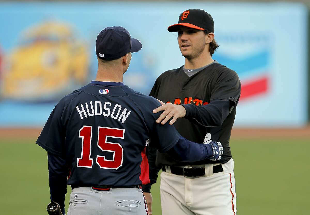 Former teammates, Tim Hudson, with the Braves and Barry Zito of the Giants, greet one another during Atlanta's practice, as the San Francisco Giants and the Atlanta Braves take to the field at AT&T Park in San Francisco, Calif., for the final day of batting practice on Wednesday Oct. 6, 2010 before the start of the National League Division Series playoffs.