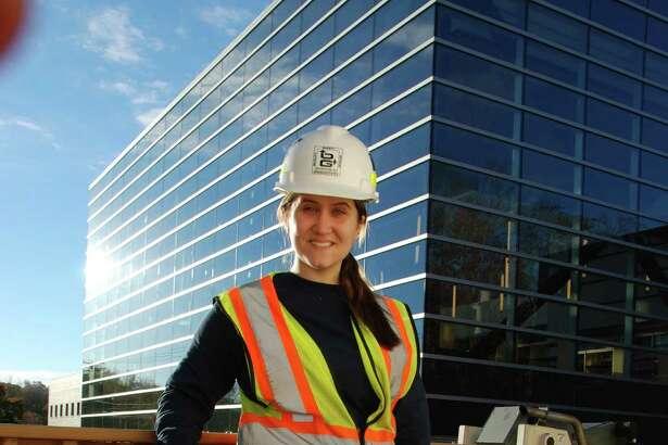 O&G project engineer Megan Semetz in front of Platt High School in Meriden.