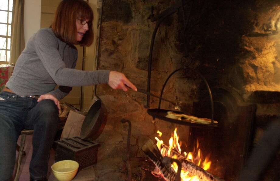 Charlotte Ferguson, an open hearth cooking teacher, demonstrates her hearth cooking techniques. Photo: Kathleen O'Rourke / Connecticut Post