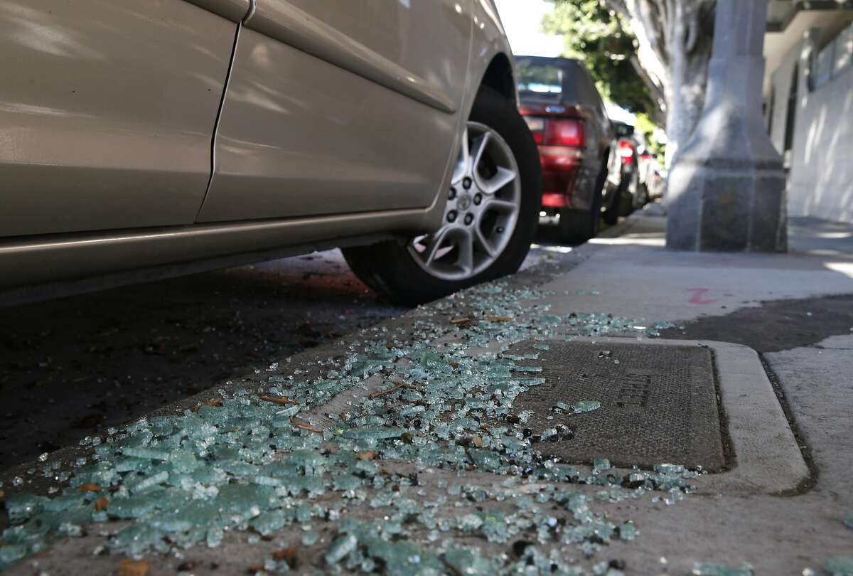 Shattered glass from a recent car break-in remains on the sidewalk on Bay Street near Kearny Street in San Francisco on Sept. 9.