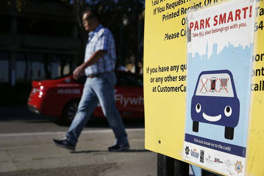 A sign posted at a parking lot on Bay Street warns motorists of car break-ins in San Francisco, Calif. on Wednesday, Sept. 9, 2015. Police officials say auto burglaries have doubled from last year, especially along Bay Street in Fisherman's Wharf, Union Square and the Embarcadero. Photo: Paul Chinn, The Chronicle