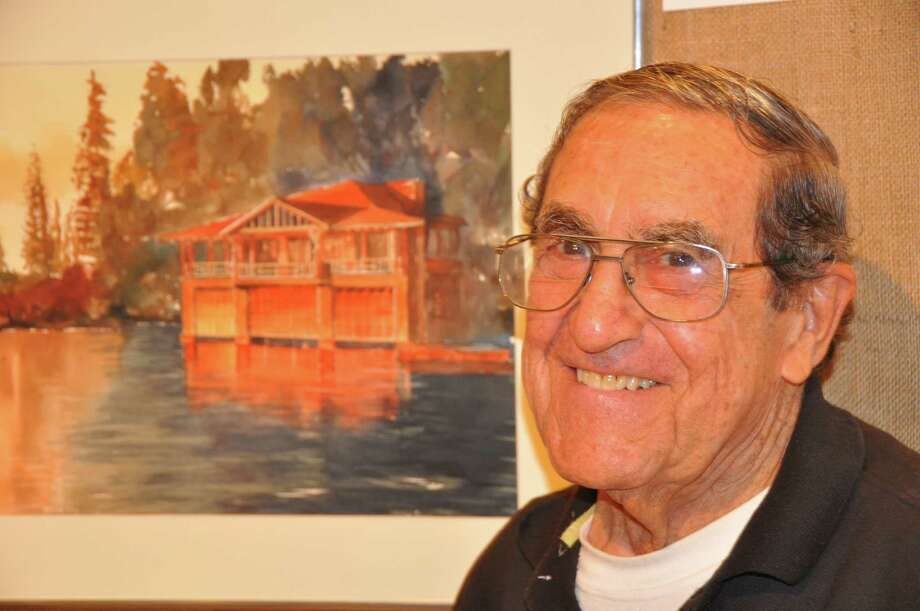 Stan Pastore, who has painted watercolors of the historic barns at Sterling Farms in Stamford, is one of the 20 artists who is scheduled to participate in the all-day outdoor exhibit at Grove Street Plaza on Saturday, Sept. 26. Photo: Contributed Photo / Darien News