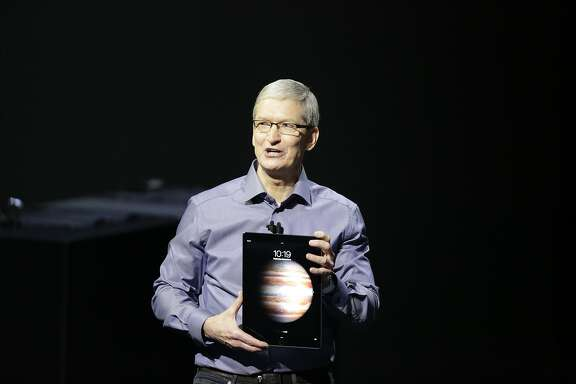Tim Cook,  chief executive officer of Apple Inc , holds the new iPad Pro during the Apple event at the Bill Graham Civic Auditorium on Wednesday, September 9, 2015 in San Francisco, Calif.