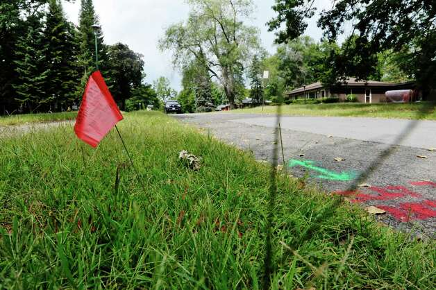 A view of a flag marking underground utilities on Loughlin St. on Wednesday, Sept. 9, 2015, in Albany, N.Y.  Columbia Development has purchased all the properties on this street, which is near the Colleges of Nanoscale Science and Engineering at SUNY Polytechnic Institute.  (Paul Buckowski / Times Union) Photo: PAUL BUCKOWSKI / 00033291A