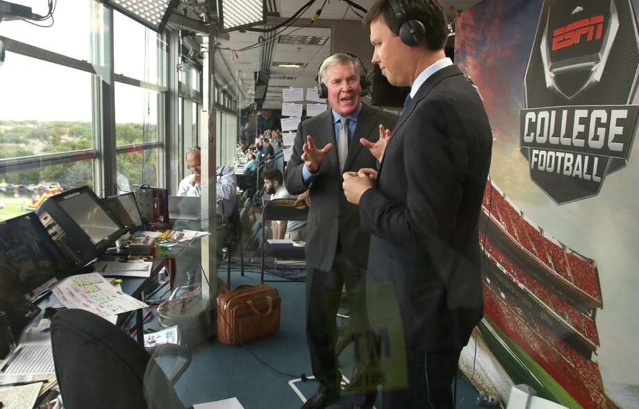 Mack Brown (left) and Dave Flemming, sportscaster for ESPN college football, (left to right) do pregame commentary before the start of the Sept. 4, 2015, Baylor-SMU game at Ford Stadium in Dallas. Photo: Todd Yates /For The Express-News / Todd Yates