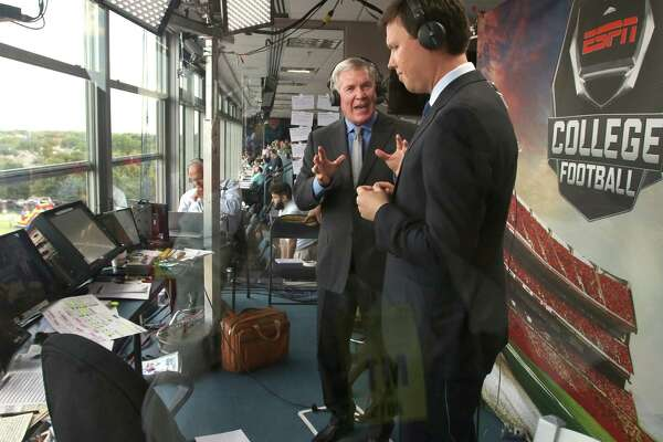 Mack Brown (left) and Dave Flemming, sportscaster for ESPN college football, (left to right) do pregame commentary before the start of the Sept. 4, 2015, Baylor-SMU game at Ford Stadium in Dallas.