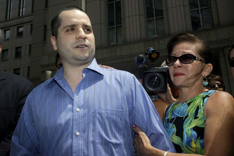 "FILE - In this July 1, 2014, file photo, with his mother Elizabeth Valle by his side, GIlberto Valle, left, makes a short statement to the assembled media as he leaves Manhattan federal court in New York.  It's clearly illegal to hack into someone else's computer network and steal information from it. But what about a police officer who uses his own department's computer database to look up women from his past? A federal appeals court in New York is weighing the issue in the case of Gilberto Valle, a former New York City police detective dubbed the ""cannibal cop"" for his online exchanges about kidnapping and eating women. Though a judge dismissed most of the case, Valle is appealing his conviction for using an NYPD database to look up women he targeted. His supporters say that action could not have been a crime because, as an officer, he was entitled to access the database. (AP Photo/Seth Weng) Photo: Seth Wenig, Associated Press"