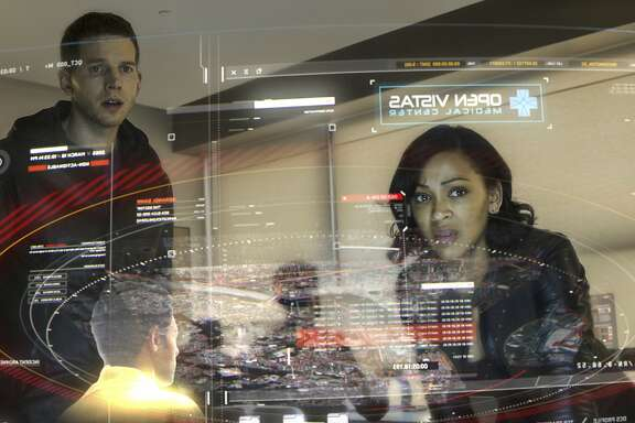 "In this image released by Fox, Meagan Good, right, and Stark Sands appear in a scene from ""Minority Report,"" premiering Monday, Sept. 21 at 9:00 EDT on Fox. (Bruce MacCauley/Fox via AP)"