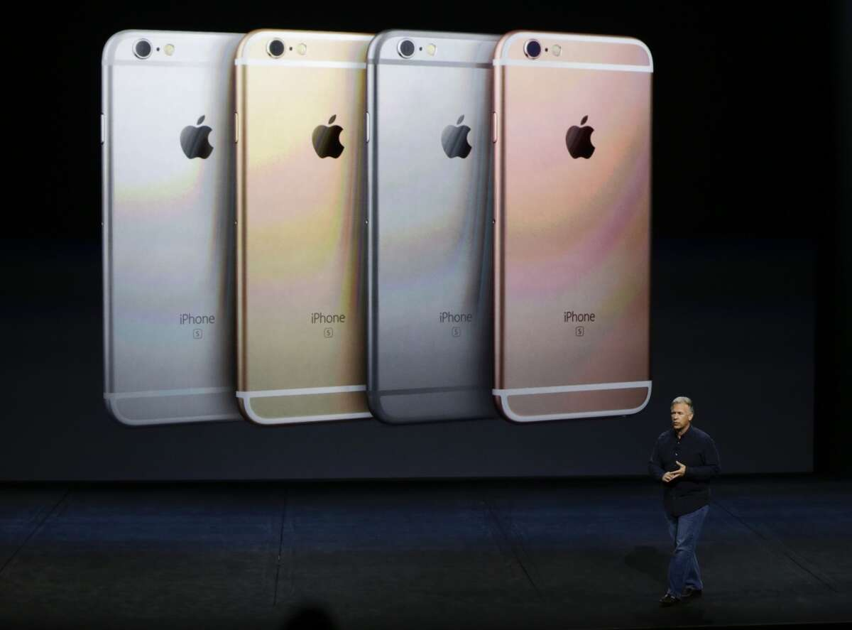 Phil Schiller, Apple's senior vice president of worldwide marketing, talks about the features of the new iPhone 6s and iPhone 6s Plus during the Apple event at the Bill Graham Civic Auditorium in San Francisco, Wednesday, Sept. 9, 2015. (AP Photo/Eric Risberg)
