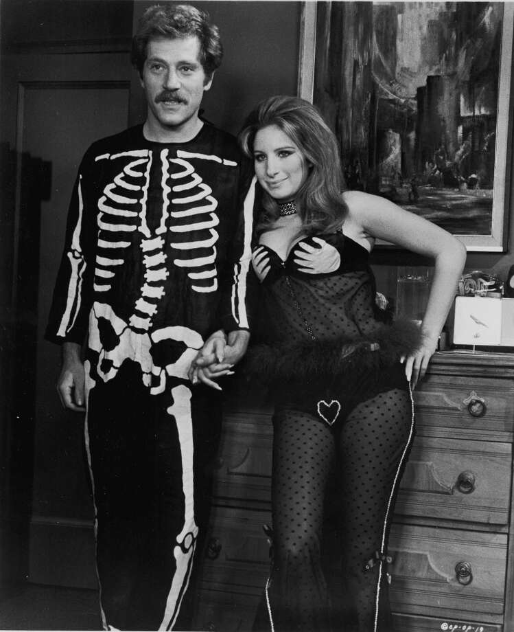 1970:American actors George Segal and Barbra Streisand hold hands, wearing Halloween costumes, in a still from the film, 'The Owl And The Pussycat,' directed by Herbert Ross, 1970. Photo: Getty Images