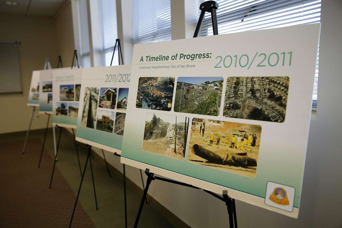 Posters arranged beside a wall showing the rebuilding effort since the San Bruno explosion five years ago during a news conference with Mayor Jim Ruane in San Bruno, California, on Wednesday, Sept. 9, 2015.