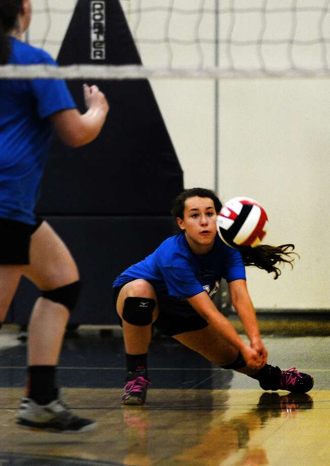 Houston Christian freshman right side Matisen Turk works the ball against Second Baptist during their scrimmage on Aug. 7, 2015. (Photo by Jerry Baker/Freelance) Photo: Jerry Baker, Freelance