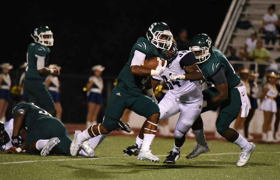 Spring senior running back Alex McCray, center, dashes away against the Nimitz defense during their matchup at Leonard George Stadium in Spring on Sept. 4. The Lions have started 2-0 for the second straight season, and they hope to duplicate last year's playoff run when they reached the third round. Photo: Jerry Baker, Freelance